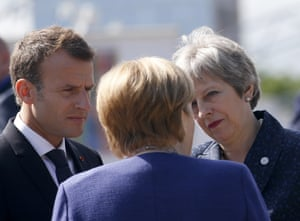 German Chancellor Angela Merkel, center, speaks with French President Emmanuel Macron, left, and British Prime Minister Theresa May after meeting at a hotel on the sidelines of the EU-Western Balkans summit in Sofia, Bulgaria, Thursday, May 17, 2018. (AP Photo/Darko Vojinovic)