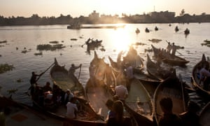Boats are docked at a ghat in the Hazaribagh neighborhood of Dhaka, Bangladesh.