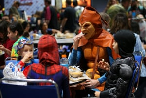 San Diego, US: Andre Rhoden, dressed as Marvel supervillain Hobgoblin, takes children to lunch on the floor at Comic-Con