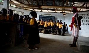 Children at the Yassa J David Christian academy in Jawajeh, a village in Liberia, prepare for class
