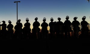 National Guard troops secure the police station in Ferguson, Missouri