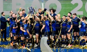 Leinster's players celebrate with the trophy.