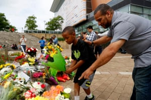 Mourners leave flowers at a memorial outside the Muhammad Ali Centre in Louisville, Kentucky