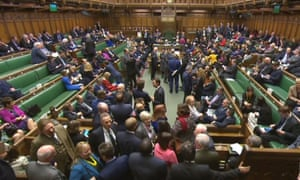 MPs filter back into the House of Commons from the lobby after voting on the article 50 bill.