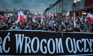 Demonstrators with a banner calling for 'Death to enemies of the homeland' at last year's far-right independence day rally in Warsaw.