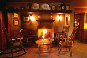 Fireside with table and chairs. Bushmills hotel, County Antrim