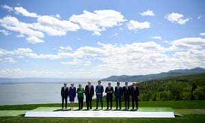 G7 leaders pose for a portrait at the summit in Charlevoix in Canada.