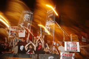 Demonstrators chant slogans against Netanyahu in front of the Knesset, Israel's parliament