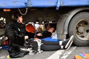 Activists attached to a lorry on Waterloo Bridge