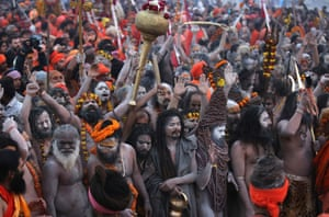 Holy men participate in a procession before taking a shahi snan or holy bath at the Sangam