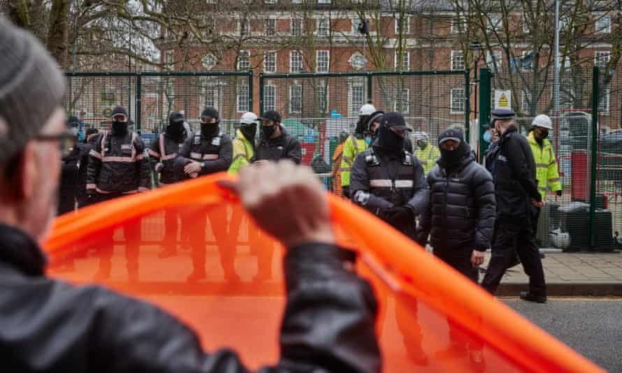 HS2 protesters in February face-off with bailiffs, security, HS2 workers and police at the entrance to the HS2 compound outside Euston station in London.