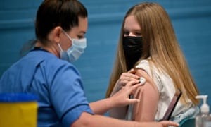 A teenager receives a Covid vaccination at the Barrhead Foundry vaccination centre near Glasgow