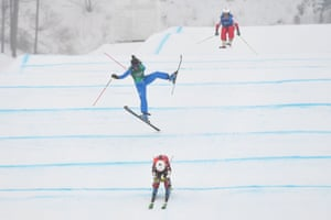 Canada's Brittany Phelan (front) leads as Italy's Debora Pixner throws some shapes in the women's ski cross final .