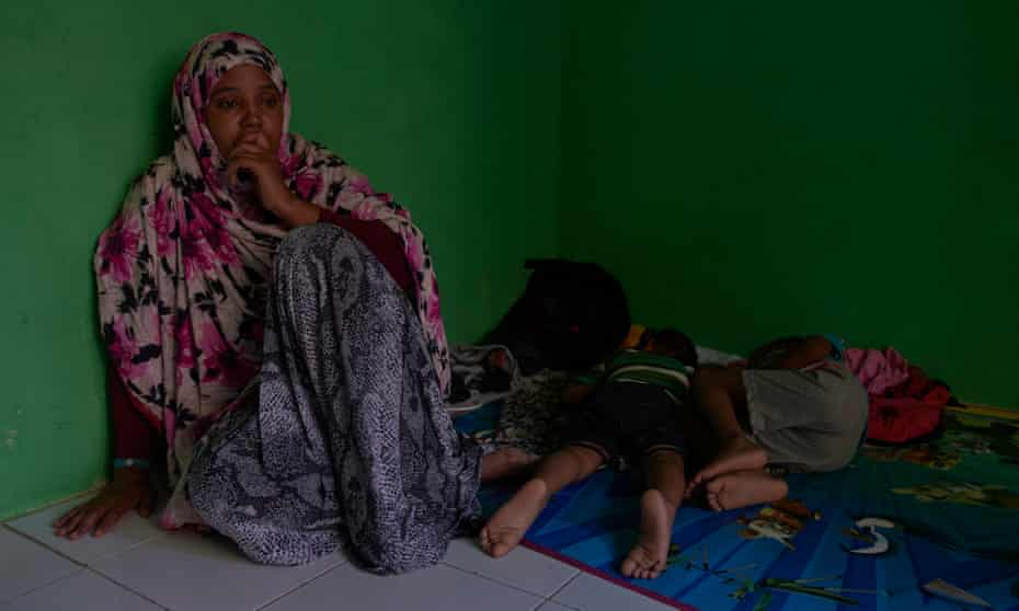A homeless Somalian refugee sits with her sick children in a fellow refugee's room in Jakarta in 2018. Refugees in Indonesia barely survive often relying on charity or the help of their families and are unable to work legally.