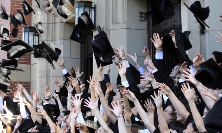 Graduating students throwing hats in the air