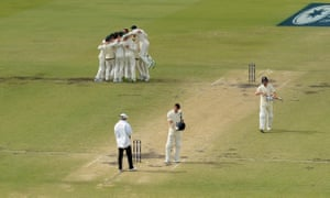 Australian players celebrate after dismissing Chris Woakes of England to regain the Ashes on the final day of the third Test in Perth.