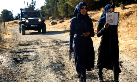 Two Palestinian girls walk to school in the south Hebron hills