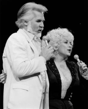 Dolly Parton performs with Kenny Rogers in 1983, the year they released Islands in the Stream