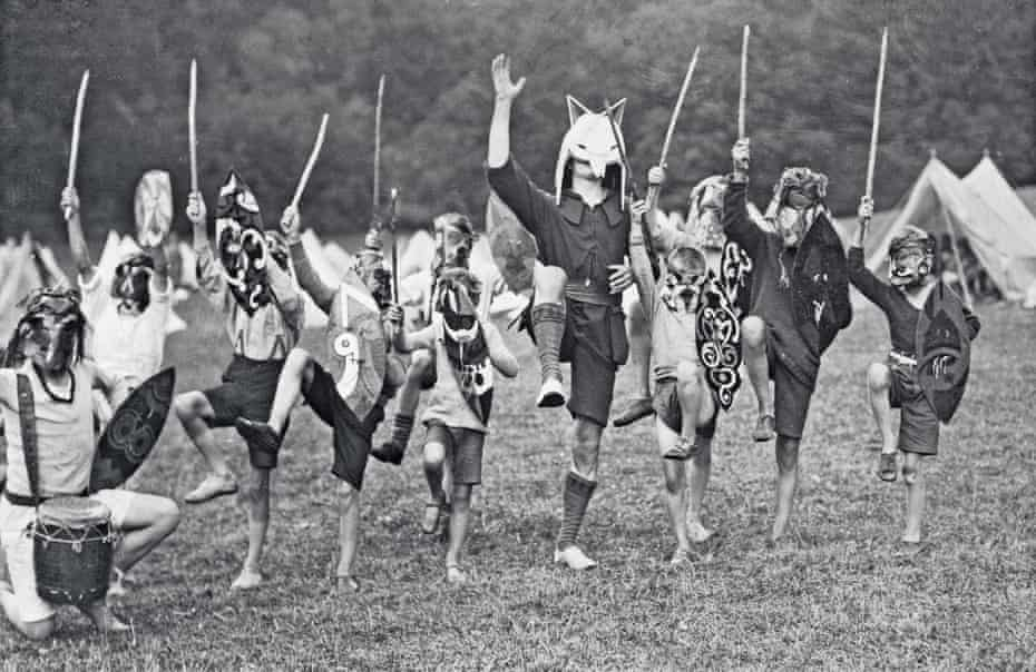 Kibbo Kift founder John Hargrave, centre, in his guise as White Fox Spirit Chief, with children at Dexter Farm tribal training camp, 1928.