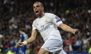 Real Madrid's Portuguese defender Pepe celebrates the goal of Real Madrid's Portuguese forward Cristiano Ronaldo