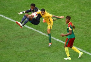 Tim Cahill colllides with Cameroon's Fabrice Ondoa.