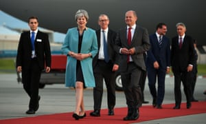 Philip Hammond, back right, arrives with Theresa May and her husband Philip in Germany for the G20.