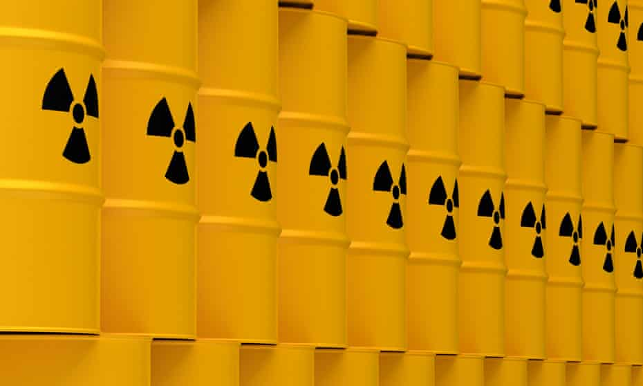 Stacks of yellow tin drums with nuclear waste warning symbol