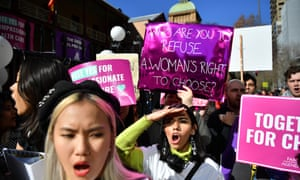 Pro-choice and anti-abortion activists hold placards in front of NSW Parliament House on Tuesday as debate began on the abortion decriminalisation bill.
