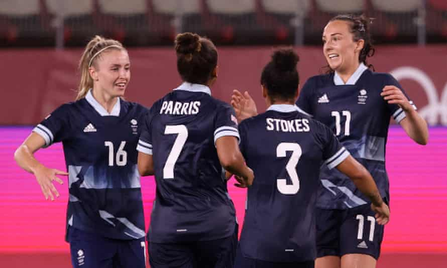 Caroline Weir (right) celebrates with Team GB colleagues after equalising against Canada at the Olympics.