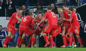 Aaron Ramsey celebrates with teammates after finally getting the breakthrough.