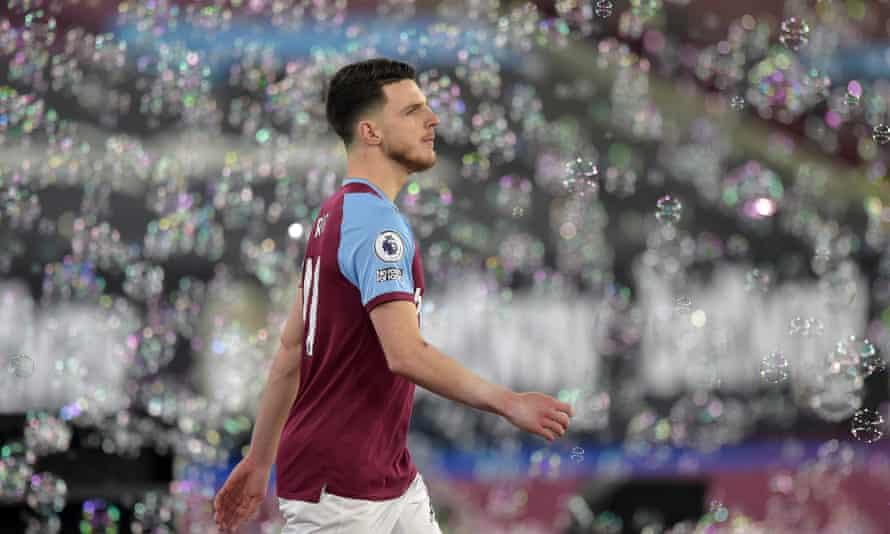 Declan Rice walks through West Ham's bubbles.