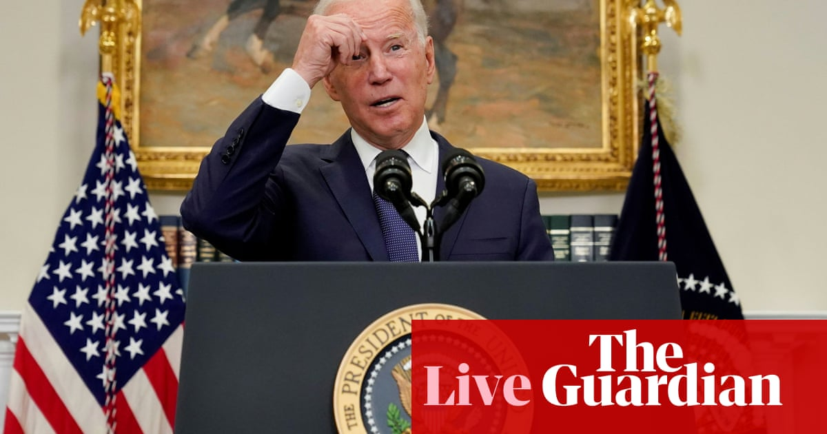 Biden's approval rating falls below 50% for first time amid chaos in Kabul – live