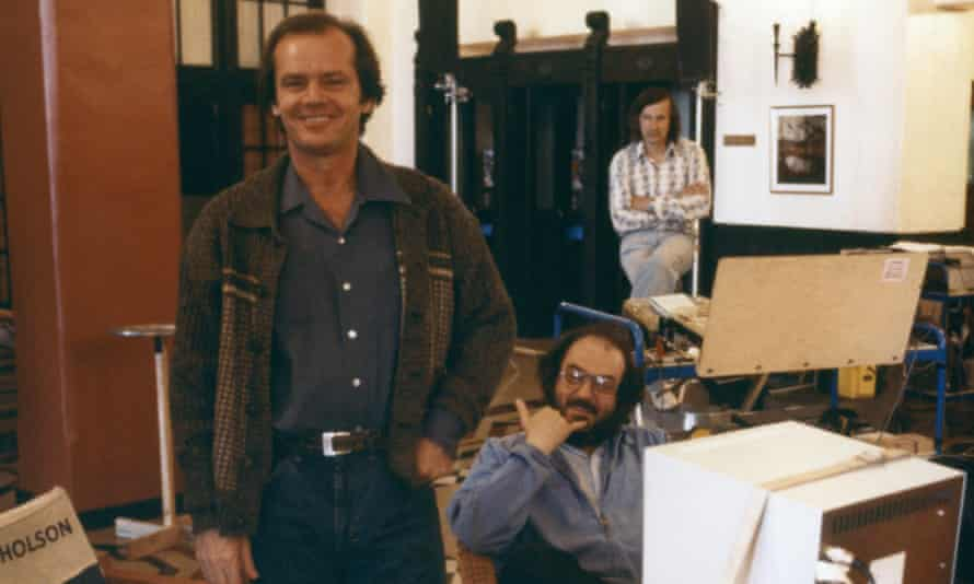 Jack Nicholson with Stanley Kubrick behind him on the set of The Shining