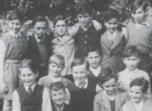 Snapshot ... Hans, centre, with cheeky grin and spotty tie, and his brother Wolfgang, standing second from left.