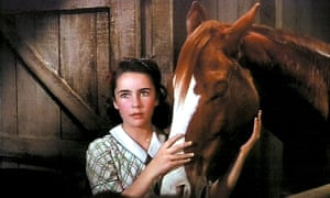 Elizabeth Taylor with her Grand National mount. They could jump 30 fences but sticking together as far as the winner's enclosure proved impossible.
