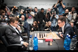 Magnus Carlsen (left) and Fabiano Caruana during the tie-breaker to decide the 2018 World Chess Championship.
