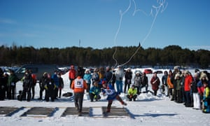 A herder participating in a lasso competition at the King race championship, Inari