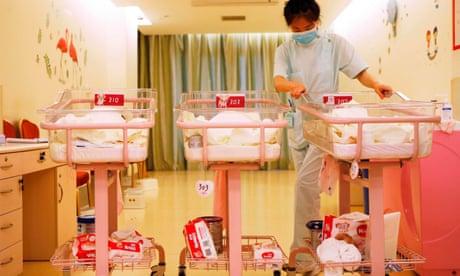A nurse taking care of newborn babies in Shanghai