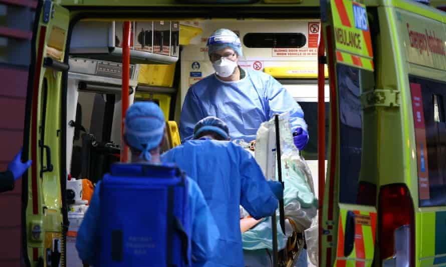 A Covid patient is transported out of an ambulance at the Royal London Hospital earlier this month.
