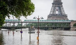 A general view of the Bir-Hakeim bridge near the Eiffel Tower above the Seine river in Paris.