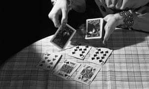 Fortuneteller Dealing Cards<br>12 Jan 1943, Burlington Mills, Virginia, USA --- A fortuneteller lays out playing cards to predict her customer's future. --- Image by   Bettmann/CORBIS