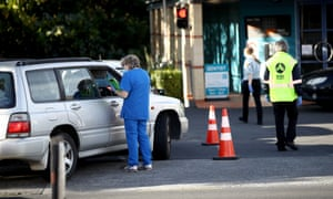 Car passengers wait for Covid-19 tests in Auckland in mid June after two people returning to New Zealand tested positive. A review has found the country's managed isolation and quarantine facilities are under 'extreme stress'.