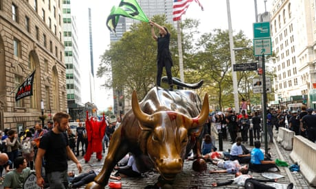 Extinction Rebellion protesters pour fake blood over New York's capitalist bull