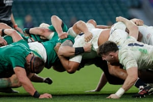 The players in a scrum.