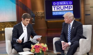 Dr Oz, left, and Donald Trump discuss the Republican presidential candidate's medical history, during a taping of The Dr Oz Show, in New York.