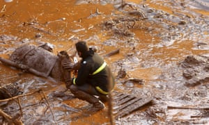 A rescue worker with a horse that had become trapped in the muddy flood.
