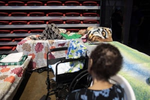 People rest in a shelter set up at the Roberto Clemente coliseum