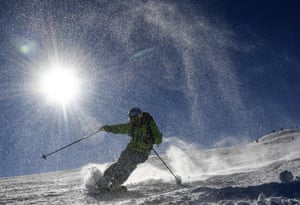 Courchevel, France: A skier takes to the slopes at the popular resort after heavy snowfall