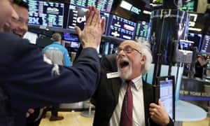 Peter Tuchman high-fives a fellow trader before the closing bell on the floor of the New York Stock Exchange on Boxing Day, when the Dow closed up more than 1,000 points