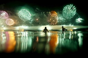 People watch fireworks during New Years celebrations at Copacabana beach in Rio de Janeiro